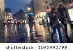 crowd of people walking on... | Shutterstock . vector #1042992799