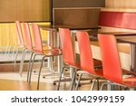 chairs and table in restaurant... | Shutterstock . vector #1042999159