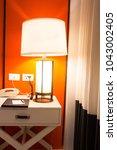 table lamp in the bedroom | Shutterstock . vector #1043002405