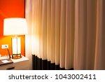 table lamp in the bedroom | Shutterstock . vector #1043002411