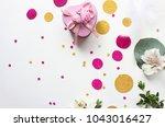 confetti. festive mood. flatlay ... | Shutterstock . vector #1043016427