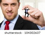 Small photo of Big businessman crushing a small one