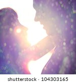 Young Couple Silhouette Huggin...