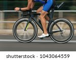 Small photo of Motion blur of a bike race with the bicycle and rider at high speed