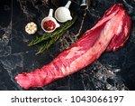 fresh raw beef tenderloin on a... | Shutterstock . vector #1043066197