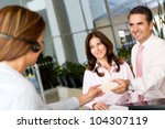 Business couple paying the hotel by credit card - stock photo