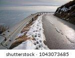 mountain road in winter  curve... | Shutterstock . vector #1043073685