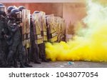 group riot police with... | Shutterstock . vector #1043077054
