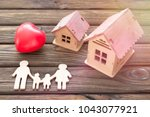 a family of wood  a figure of a ... | Shutterstock . vector #1043077921