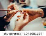 manicure in beauty salon.... | Shutterstock . vector #1043081134