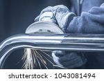 metal polishing with a hand... | Shutterstock . vector #1043081494