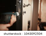 installation of a lock in the... | Shutterstock . vector #1043092504