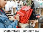 woman in shop choosing leather...   Shutterstock . vector #1043094169
