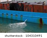 Large oil containers loaded on a shipping barge in the harbor for transport. - stock photo