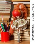 beautiful doll with an apple... | Shutterstock . vector #1043107471