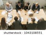 happy multiracial businessmen... | Shutterstock . vector #1043108551