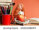 beautiful doll with an apple... | Shutterstock . vector #1043108695