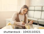 beautiful woman  work in office. | Shutterstock . vector #1043110321