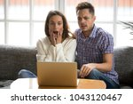 shocked couple feeling confused ... | Shutterstock . vector #1043120467