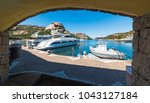 luxury yachts seen from an arch ... | Shutterstock . vector #1043127184