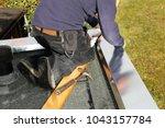 plumbing work on a flat roof | Shutterstock . vector #1043157784