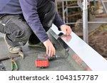 plumbing work on a flat roof | Shutterstock . vector #1043157787