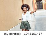young attractive black woman in ... | Shutterstock . vector #1043161417