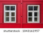 windows with a red wall | Shutterstock . vector #1043161957