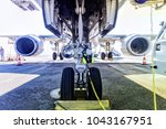 fueling and final checking... | Shutterstock . vector #1043167951