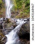 beautiful pristine waterfall in ... | Shutterstock . vector #1043168467