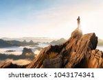 businessmen stand on high peaks ... | Shutterstock . vector #1043174341