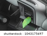 green leaf in the car air.... | Shutterstock . vector #1043175697