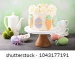 carrot cake with cream cheese... | Shutterstock . vector #1043177191