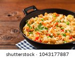 fried rice with chicken.... | Shutterstock . vector #1043177887