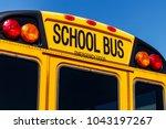 yellow school bus in a district ... | Shutterstock . vector #1043197267