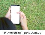 female hand holding the... | Shutterstock . vector #1043208679