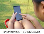 female hand holding the... | Shutterstock . vector #1043208685