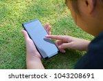 female hand holding the... | Shutterstock . vector #1043208691
