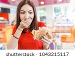 Woman With Burger In Hand ...