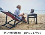 freelancer artist with laptop... | Shutterstock . vector #1043217919