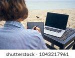 freelancer artist with laptop... | Shutterstock . vector #1043217961