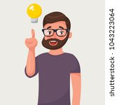 manin in glasses with beard and ... | Shutterstock .eps vector #1043223064