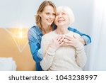 feeling warmth. beautiful young ... | Shutterstock . vector #1043238997