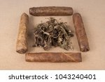 tobacco on wooden background | Shutterstock . vector #1043240401