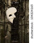 Masquerade - Phantom of the Opera Mask on Weathered Fence - stock photo