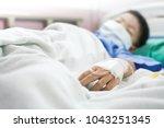 asian boy sleeping on patient... | Shutterstock . vector #1043251345