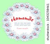 wreath of chamomile flowers ... | Shutterstock .eps vector #1043258461