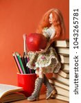 beautiful doll with an apple... | Shutterstock . vector #1043265781