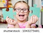 child girl holding two big... | Shutterstock . vector #1043275681