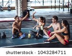 group of sporty muscular people ... | Shutterstock . vector #1043284711